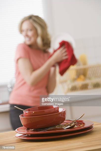 Woman washing dirty dishes