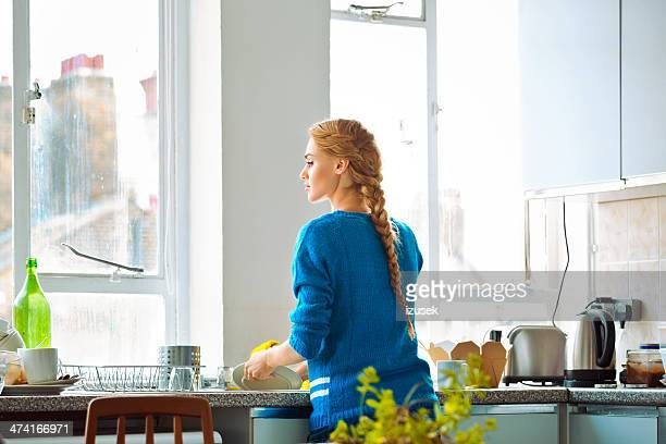 Woman washing dishes