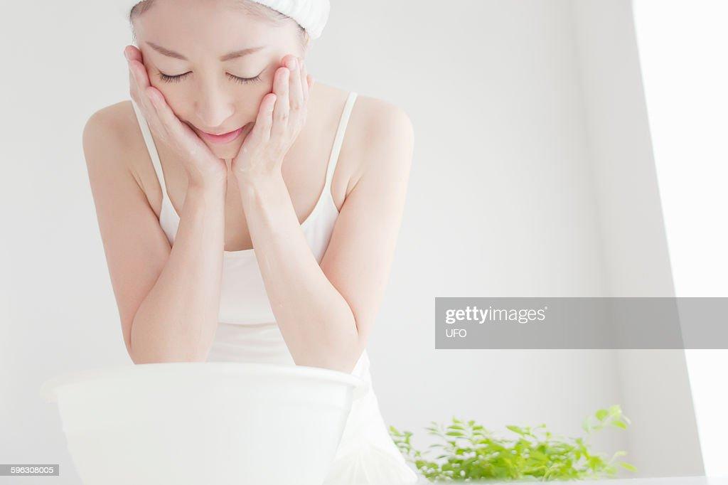 Woman washing face : Stock Photo