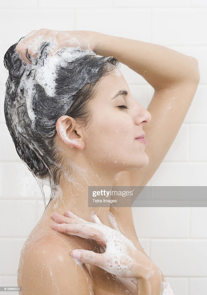 Woman washing hair in shower : Stock Photo