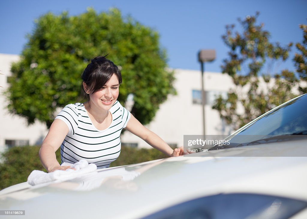 woman washing her car : Stock Photo