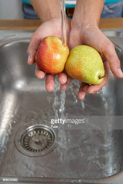 Woman Washing Pears in the Sink