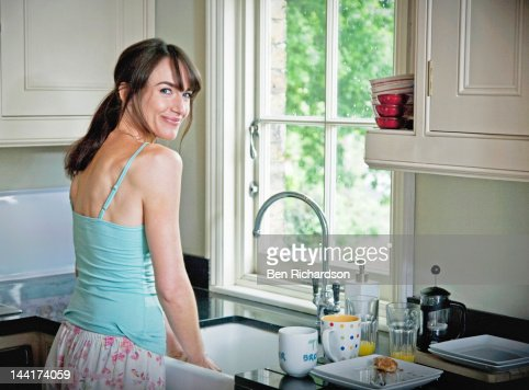 Woman washing up at home