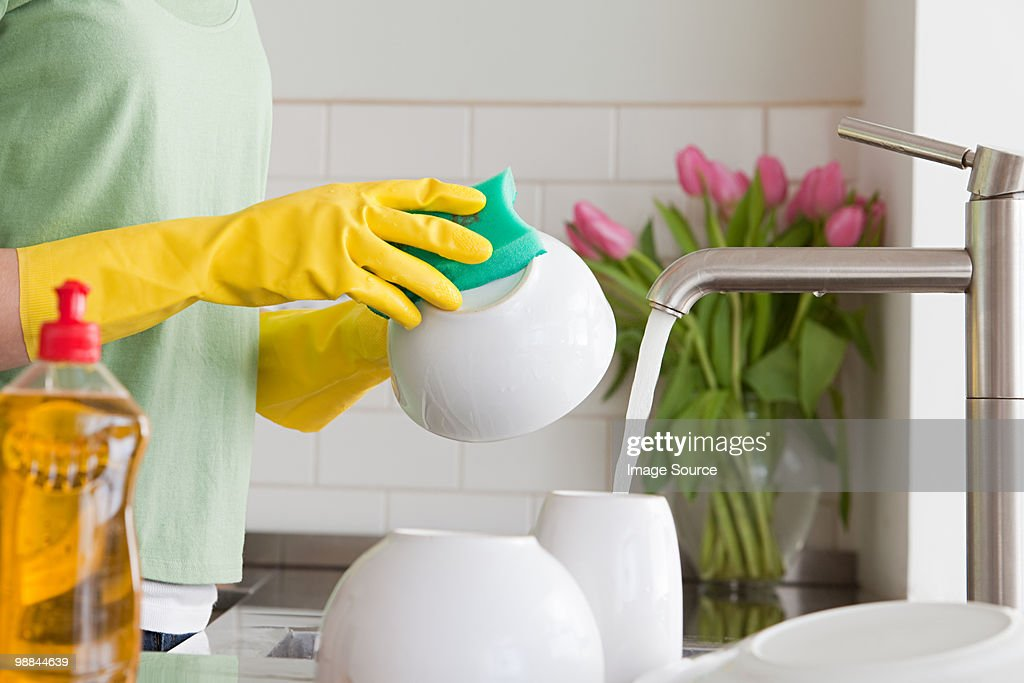 Woman washing up : Stock Photo