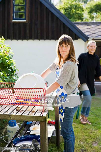 Woman washing utensils