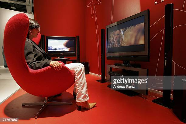 A woman watches a movie on a flat screen television at the Internationale Funk Ausstellung on September 1 2006 in Berlin Germany The 'IFA'...