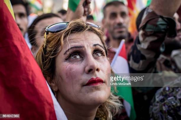 A woman watches on during a protest outside the US Consulate on October 21 2017 in Erbil Iraq The demonstration was held to protest against the...