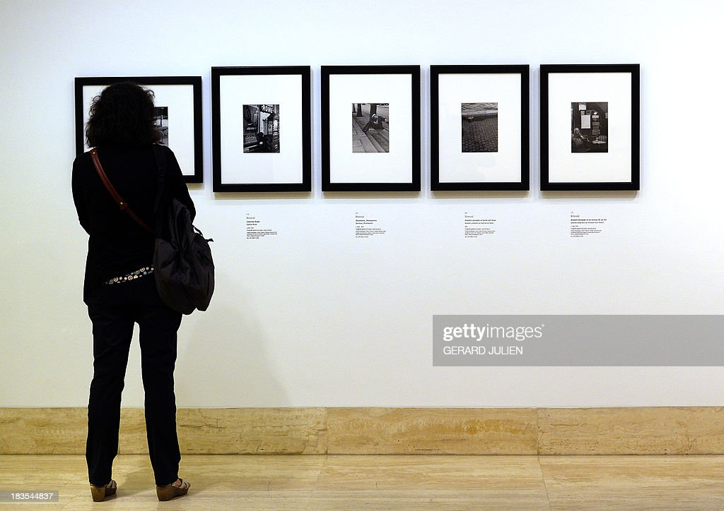 A woman watches photographs of Brassaï during the exhibition entitled 'Surrealism and the Dream' at the Thyssen-Bornemisza museum in Madrid, on October 7, 2013. AFP PHOTO/ GERARD JULIEN