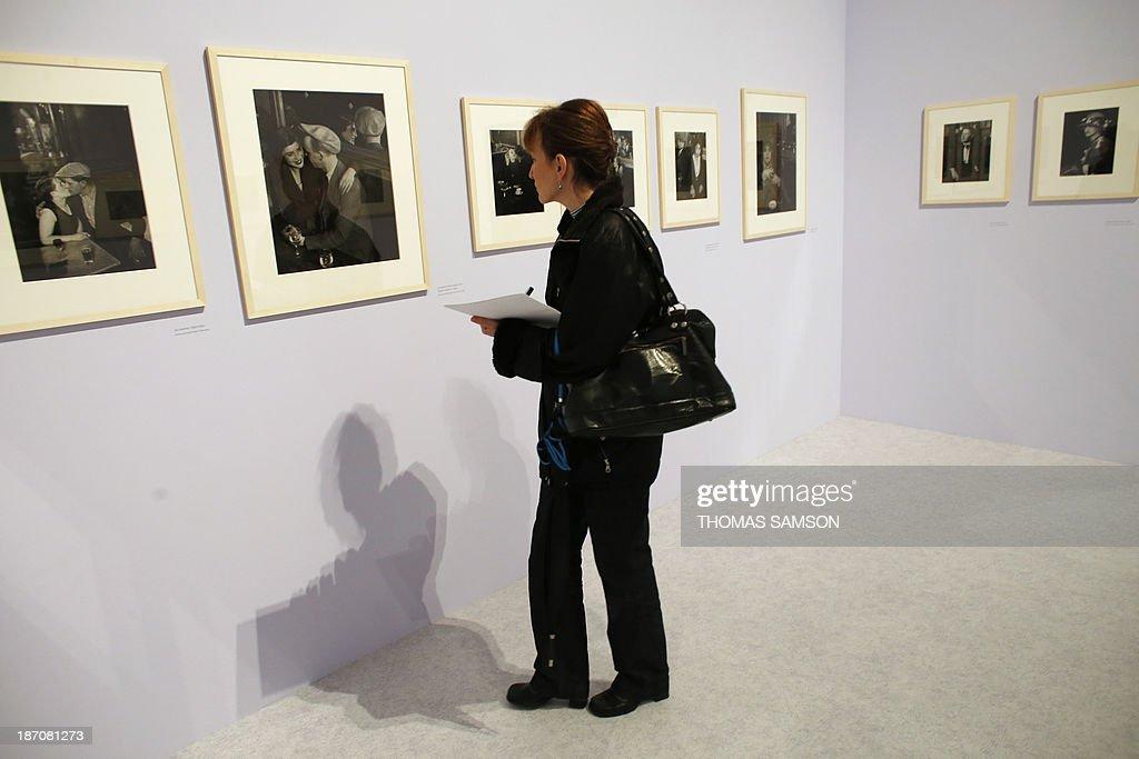 A woman watches photographs of Brassai during the exhibition entitled 'Brassai, pour l'amour de Paris' ('Brassai, for the love of Paris') at the Hotel de Ville of Paris, on November 6, 2013.