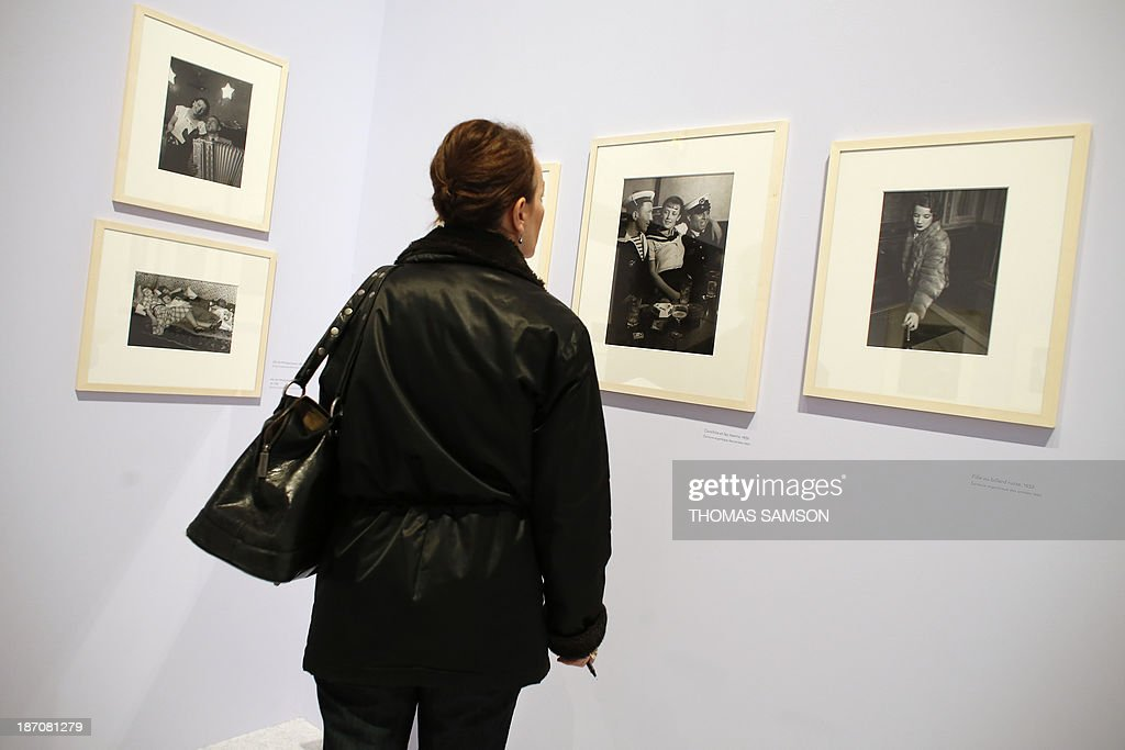 A woman watches photographs of Brassai during the exhibition entitled 'Brassai, pour l'amour de Paris' ('Brassai, for the love of Paris') at the Hotel de Ville of Paris, on November 6, 2013.
