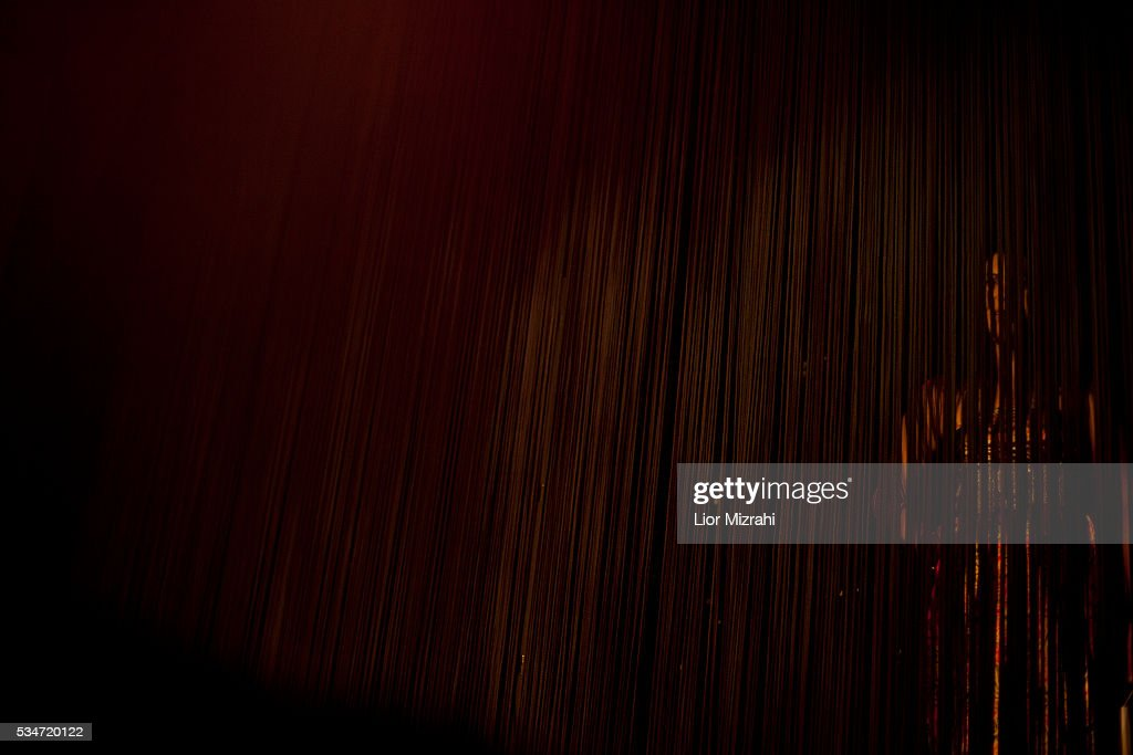 A woman watches the first Miss Trans Israel beauty pageant on May 27, 2016 in Tel Aviv, Israel. Twelve Israeli transgender finalists took part in the event. The event marks the beginning of the 2016 Pride events.