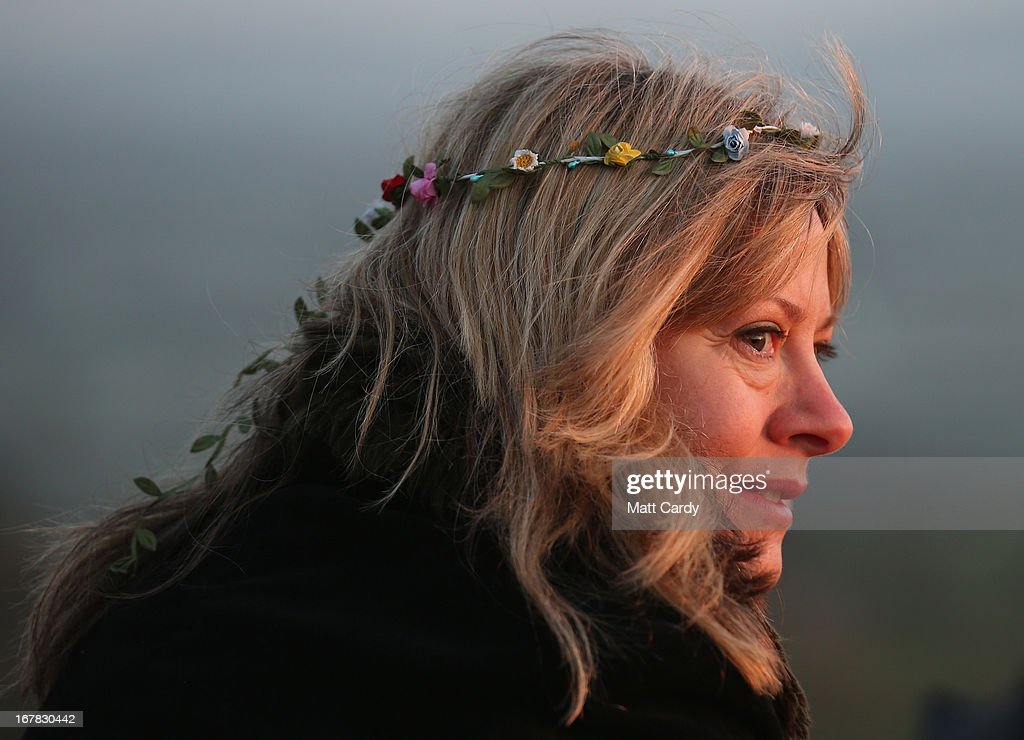 A woman watches the sun rise during a Beltane dawn celebration service in front of St. Michael's Tower on Glastonbury Tor on May 1, 2013 in Glastonbury, England. Although more synonymous with International Workers' Day, or Labour Day, May Day or Beltane is celebrated by druids and pagans as the beginning of summer and the chance to celebrate the coming of the season of warmth and light. Other traditional English May Day rites and celebrations include Morris dancing and the crowning of a May Queen with celebrations involving a Maypole.