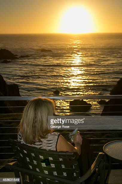 A woman watches the sun set over the Pacific Ocean near the Mendocino Coast Botanical Gardens on September 6 in Fort Bragg California Located three...
