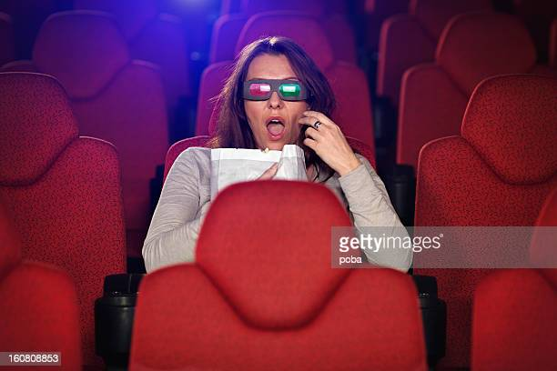 woman watching 3D Film In Cinema alone
