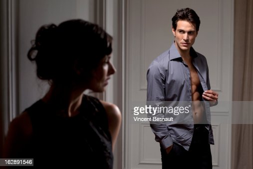A woman watching a man undressing