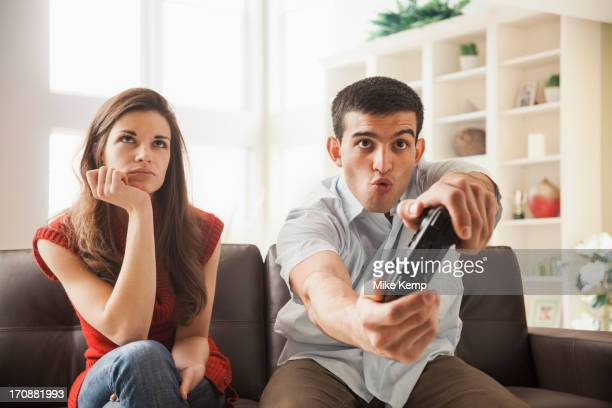 Woman watching boyfriend play video games