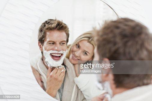 Woman watching boyfriend shave