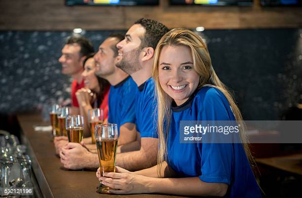 Woman watching football at a sports bar