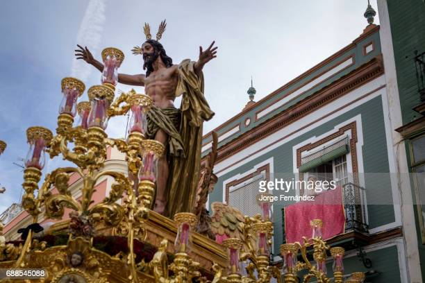Woman watching from her balcony how an image of Jesus Christ is paraded during an Easter procession During the Easter week processions with the image...