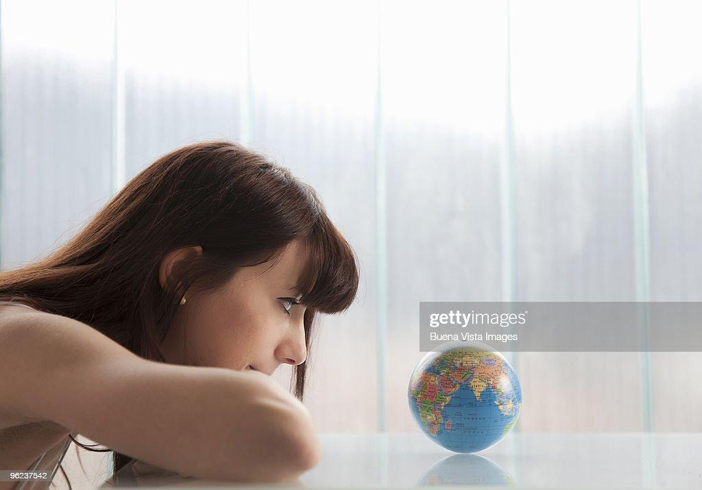 Woman watching globe. : Stock Photo