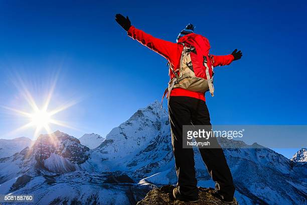 Woman watching sunrise over Himalayas, Mount Everest National Park