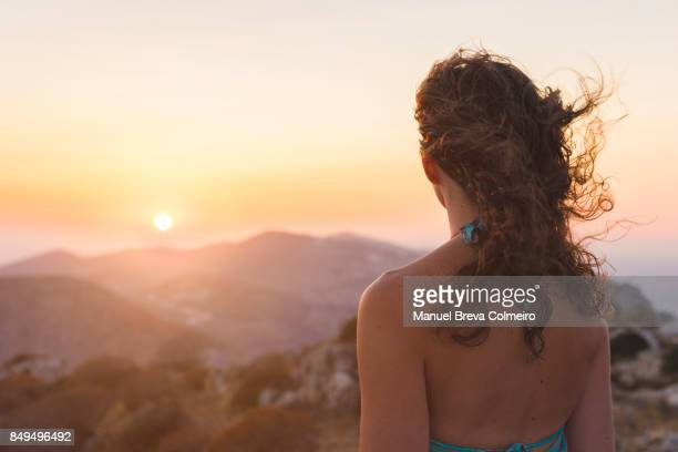 Woman watching the sunset