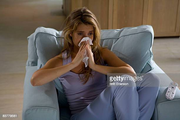 Woman watching tv, crying
