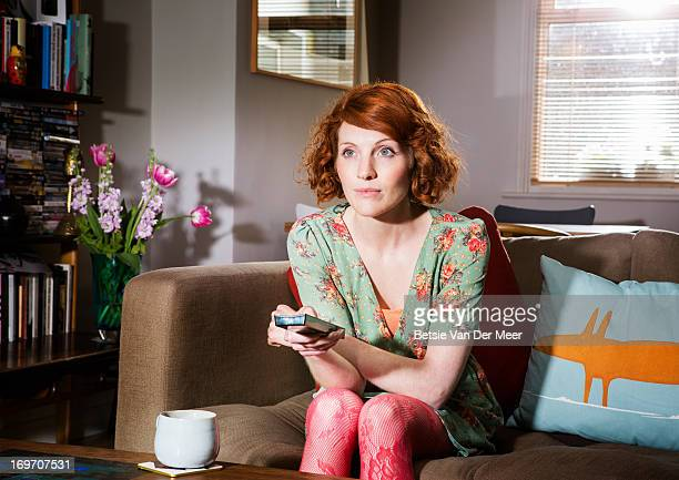 Woman watching tv in livingroom.