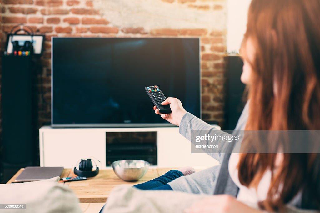 Woman watching TV : Stock Photo