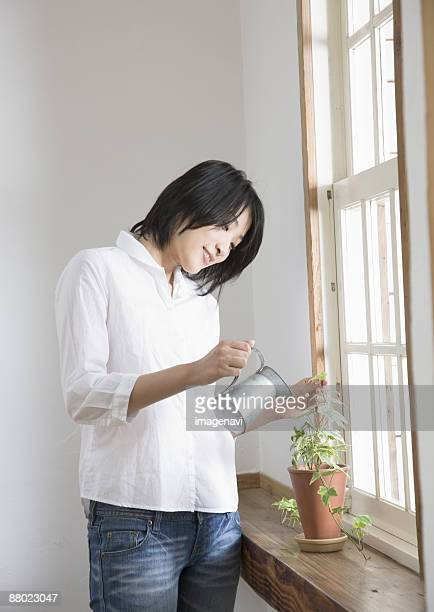 A woman watering