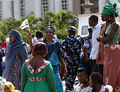 A woman waves a flag during the swearing in of Nigeria's new president Muhammadu Buhari on May 29 2015 in Abuja Nigeria Buhari a former general in...