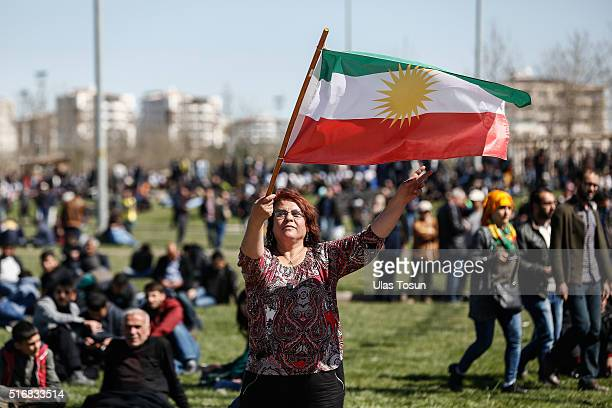 A woman waves a Kurdistan flag during Newroz celebrations on March 21 2015 in Diyarbakir Turkey Thousands of Kurds gather for the Newroz spring...