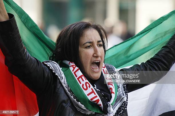 A woman waves a Palestinian flag as she takes part in a proPalestinian demonstration on October 10 2015 in Paris calling for a boycott of Israel and...