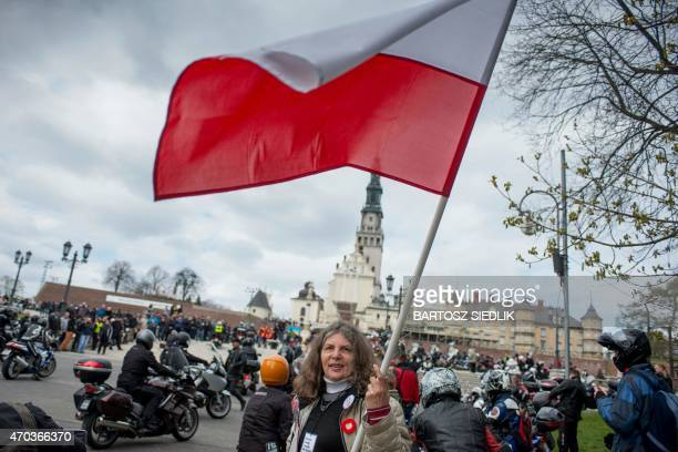 A woman waves a Polish flag in front of the Jasna Gora monastery during the annual Polish motorcyclists pilgrimage to the country's greatest place of...