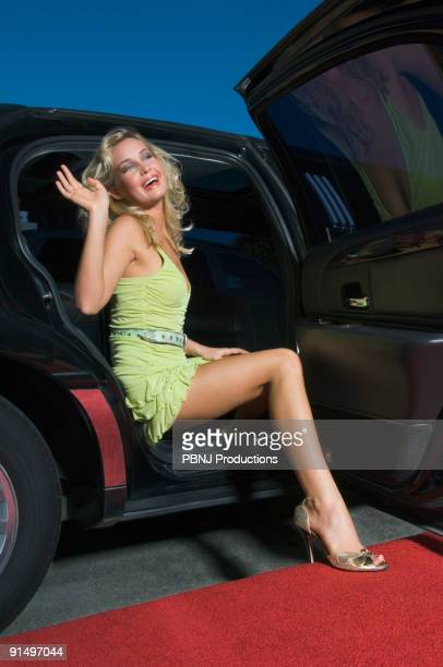 Woman waving from limousine