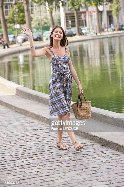 Woman waving her hand and smiling, Paris, Ile-de-France, France