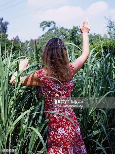 Woman Waving in Garden