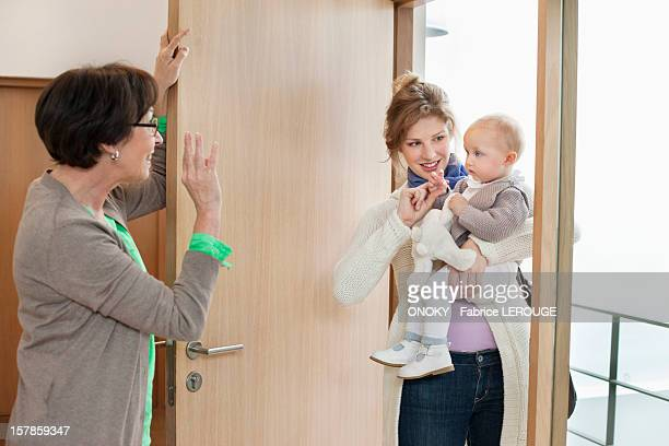 Woman waving to her daughter