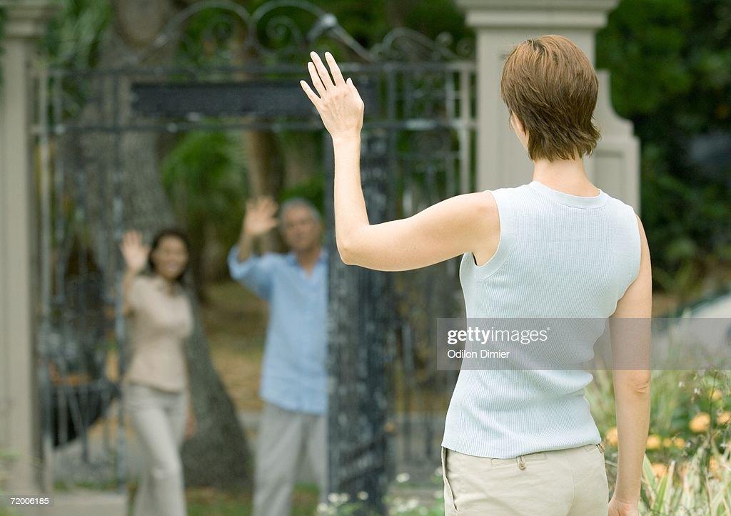 Woman waving to neighbors