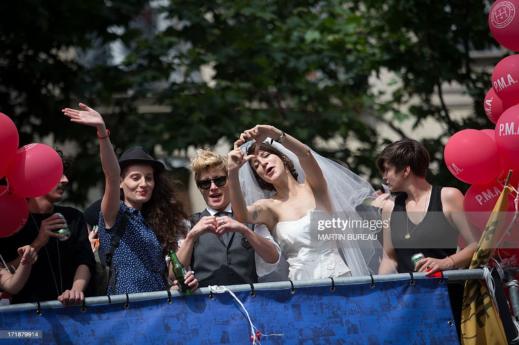 A woman wear a bride dress during the homosexual, lesbian, bisexual and transgender (HLBT) visibility march, the Gay Pride, on June 29, 2013 in Paris, exactly one month to the day since France celebrated its first gay marriage. AFP PHOTO / MARTIN BUREAU
