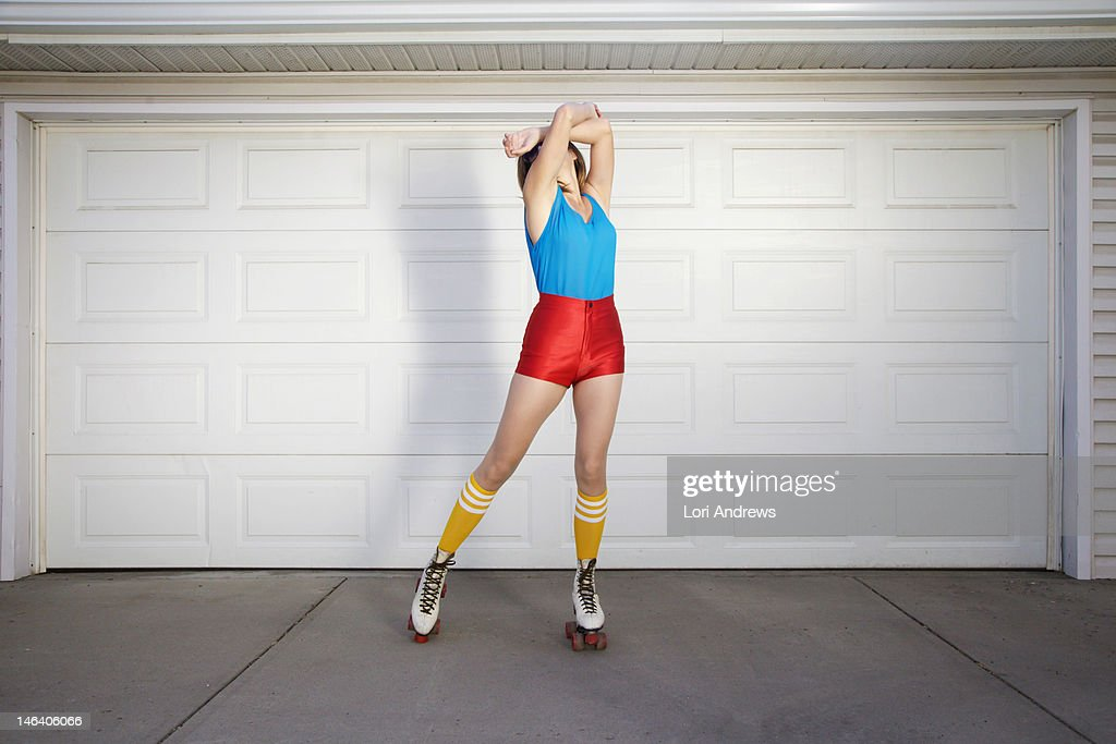 Woman wearing 70's roller skates : Stock Photo