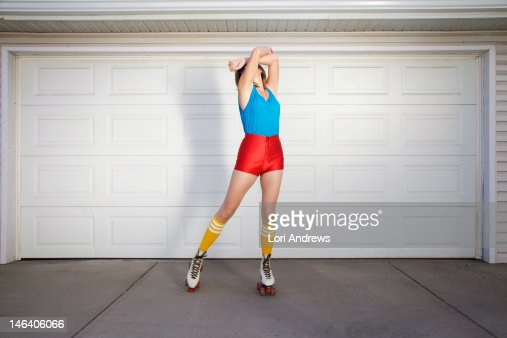 Woman wearing 70's roller skates : Stock Photo