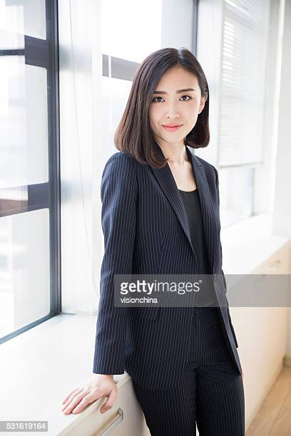 woman wearing a black suit