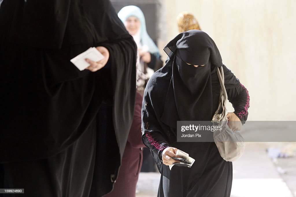 A woman wearing a burka holds documents as Jordanians vote in the parliamentary elections on January 23, 2013 in the city of Zarqa, Jordan. Jordan's election is being boycotted by the Muslim Brotherhood's political wing, the Islamic Action Front (IAF), who claim that the system is rigged favorably to supporters of the king, who for the first time will appoint the new prime minister.