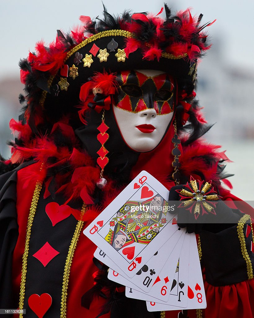 A woman wearing a Carnival Costume poses in front of the Bridge of Sigh on February 9, 2013 in Venice, Italy. The 2013 Carnival of Venice runs from January 26 - February 12 and includes a program of gala dinners, parades, dances, masked balls and music events.