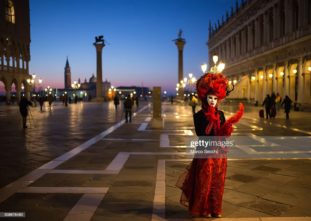 A woman wearing a carnival costume poses in Piazza San Marco on February 06, 2016 in Venice, Italy. The 2016 Carnival of Venice will run from January 23 to February 9 and includes a program of gala dinners, parades, dances, masked balls and music events.