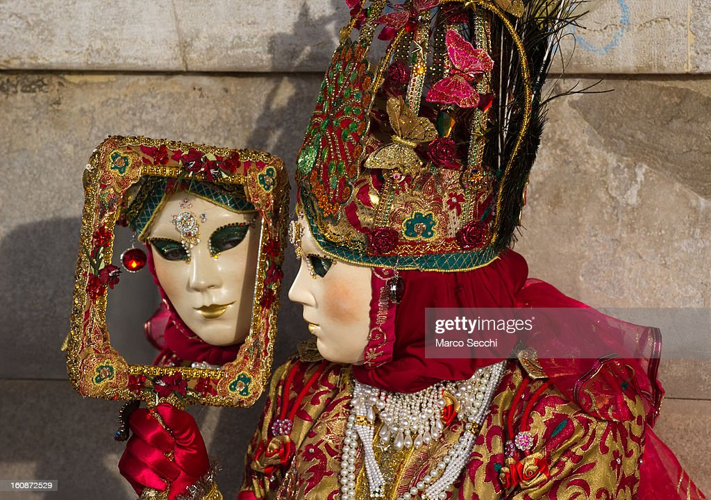 A woman wearing a Carnival Costume poses in Saint Mark's Square on February 7, 2013 in Venice, Italy. The 2013 Carnival of Venice runs from January 26 - February 12 and includes a program of gala dinners, parades, dances, masked balls and music events.