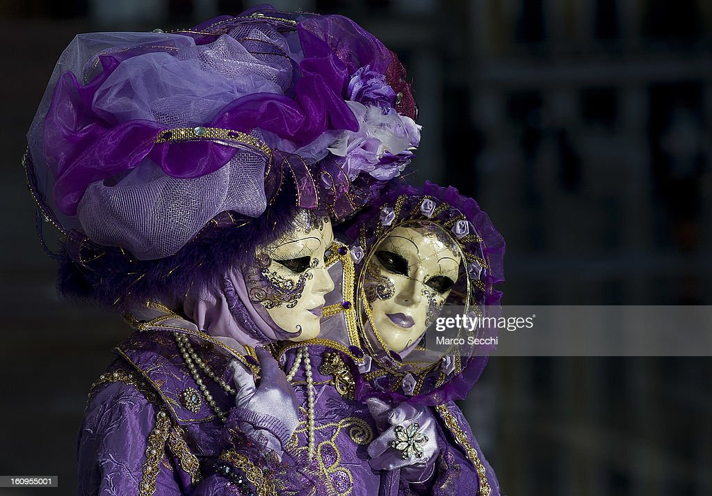 A woman wearing a carnival costume poses in Saint Mark's Square on February 8, 2013 in Venice, Italy. The 2013 Carnival of Venice runs from January 26 - February 12 and includes a program of gala dinners, parades, dances, masked balls and music events.