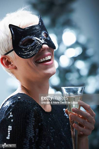 Woman wearing a cat mask