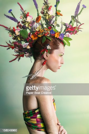 woman wearing a colorful floral mohawk : Stock Photo